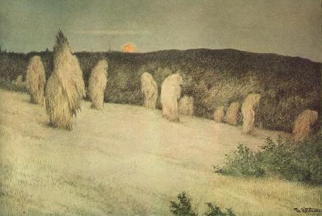 stooks of  corn in moonlight